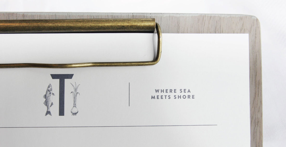 food menu on wooden clipboard, innovative restaurant logo design with seafood and vegetable illustrations