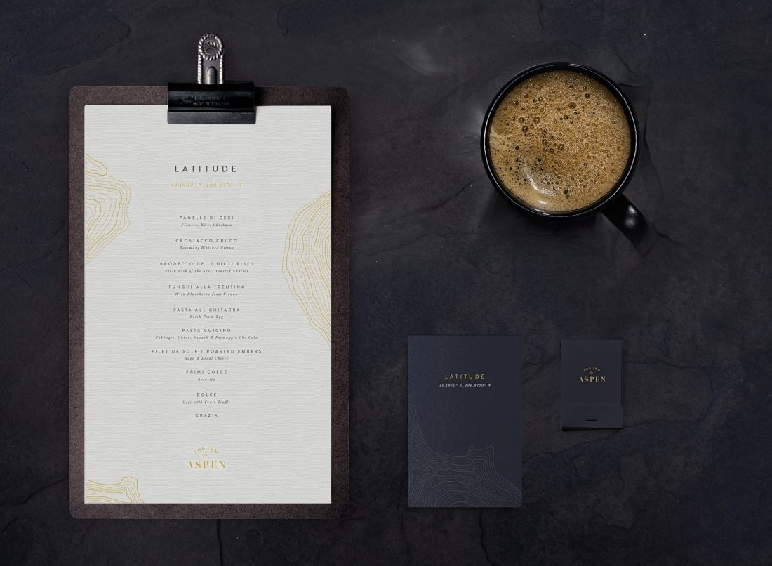 creative menu design on wooden clipboard, print collateral for CO ski resort, art direction by creative agency