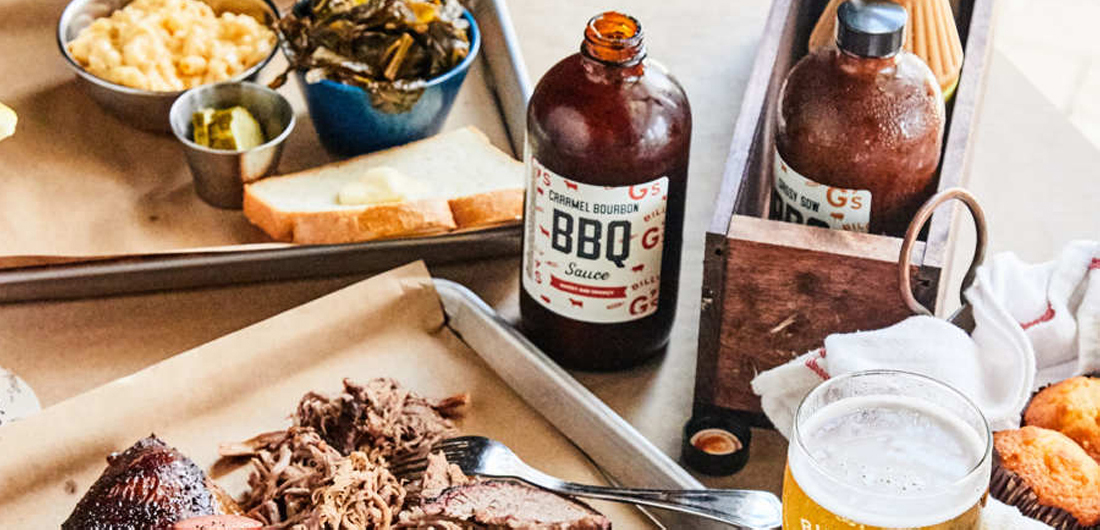 BBQ food and sauce bottle on table, custom label design for glassware, barbecue restaurant in hotel