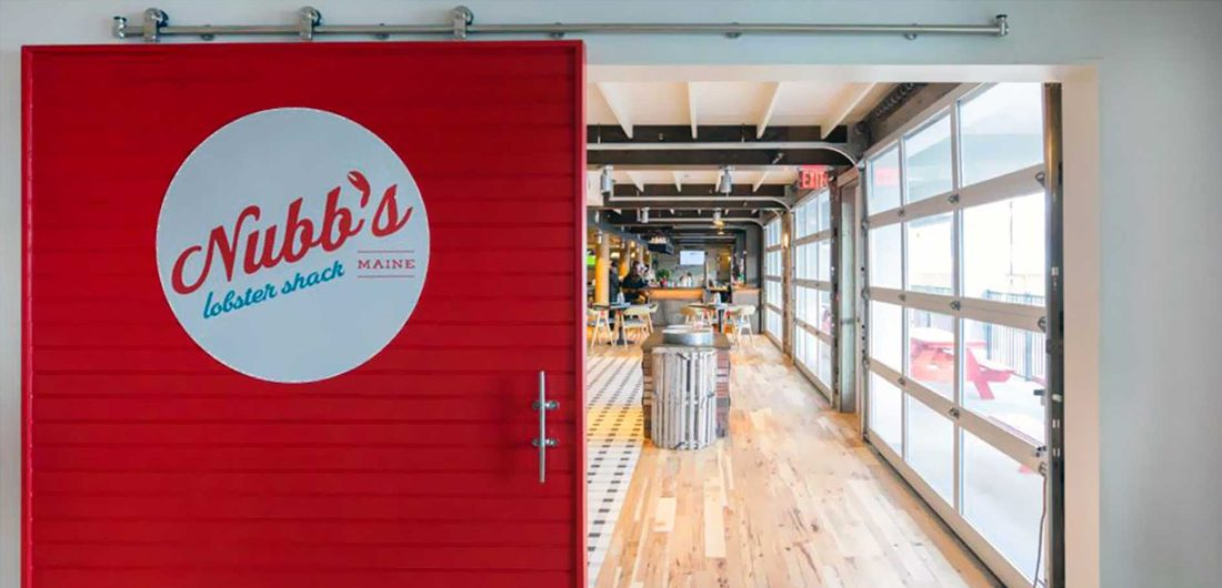 entrance of lobster shack in hotel with sliding door, signage and print collateral with unique, creative logo